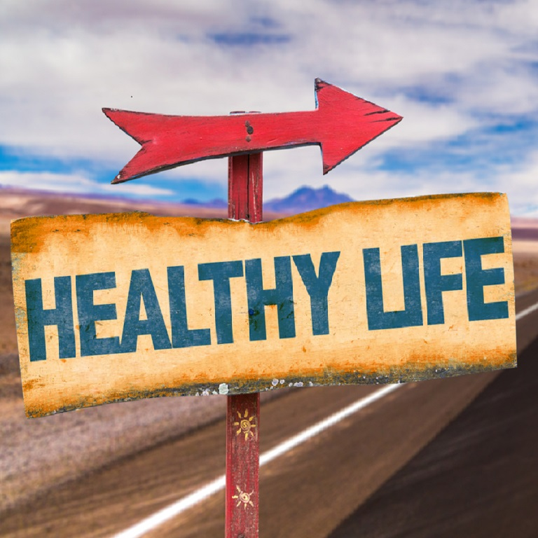 Healthy Life sign with road background